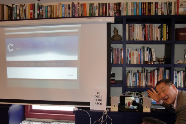 Ye Olde Euro Paco gives a presentation remotely from London as, um Scott tinkers with the iPad volume control.