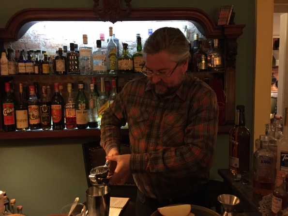 Our  mystery host behind the bar